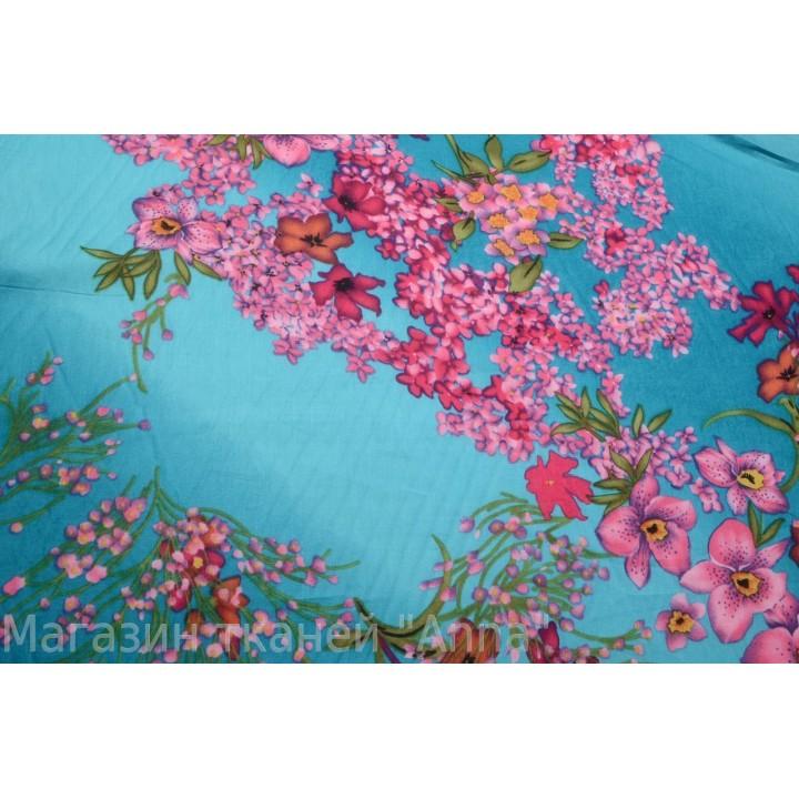 Тонкий хлопок (немного светится) с мелкими цветами а небесно-голубом фоне.
