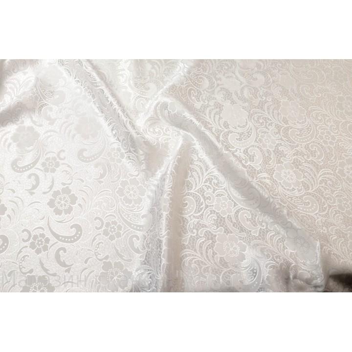 Тонкий атласный жаккард в белом цвете, хорошо драпируется.