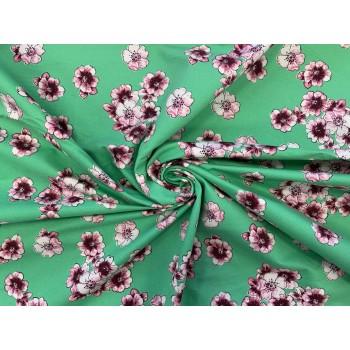 Цветы на ярком зеленом фоне хлопка