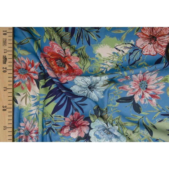 Купить крупные цветы на ярко-голубом фоне