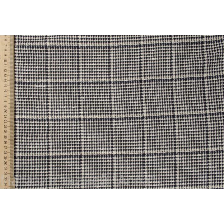 Черно-белая мелкая клетка в тонкой костюмной шерсти