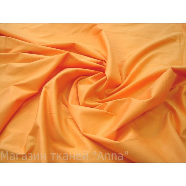 Коттон стрейч спокойного оранжевого цвета - мягкий, но плотный хлопок