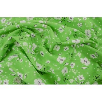 Яркий зеленый лен с маленькими цветами