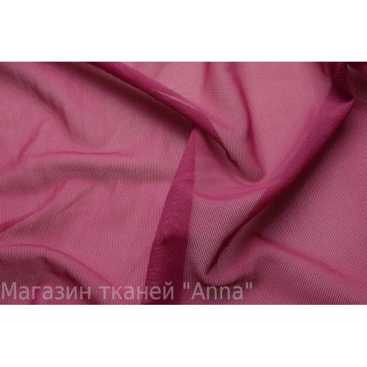 Сетка стрейч с мелкой ячейкой насыщенного розового оттенка.
