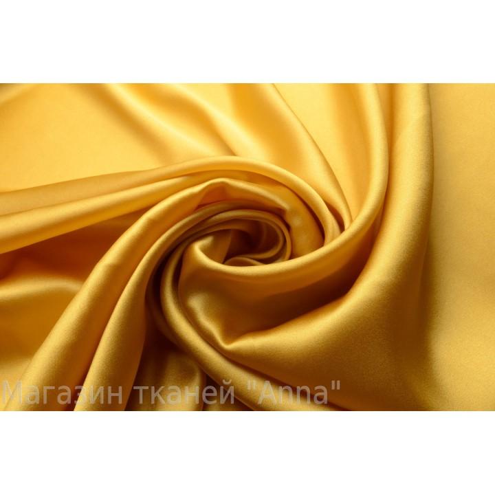 Атласный шелк цвета желтого золота