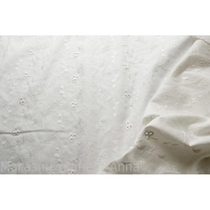 Хлопок-шитье белого цвета с мелкой вышивкой.