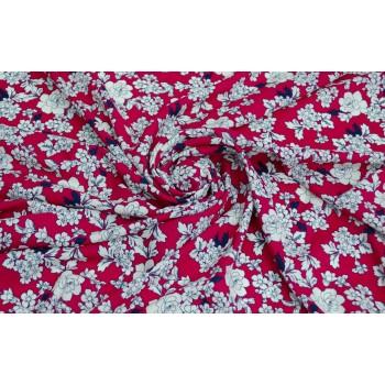 Светлые мелкие цветочки на ярком красном фоне штапеля