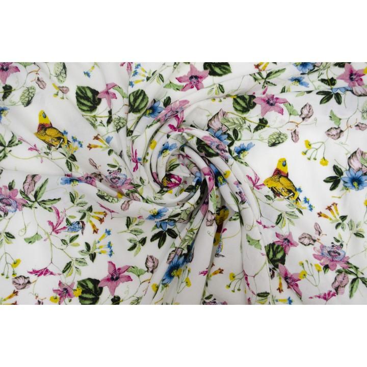 Белый штапель с мелким и ярким узором из цветов и птиц