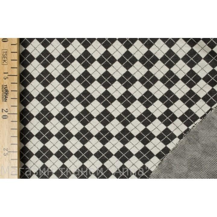 Трикотаж в шахматную клетку черно-белого цвета